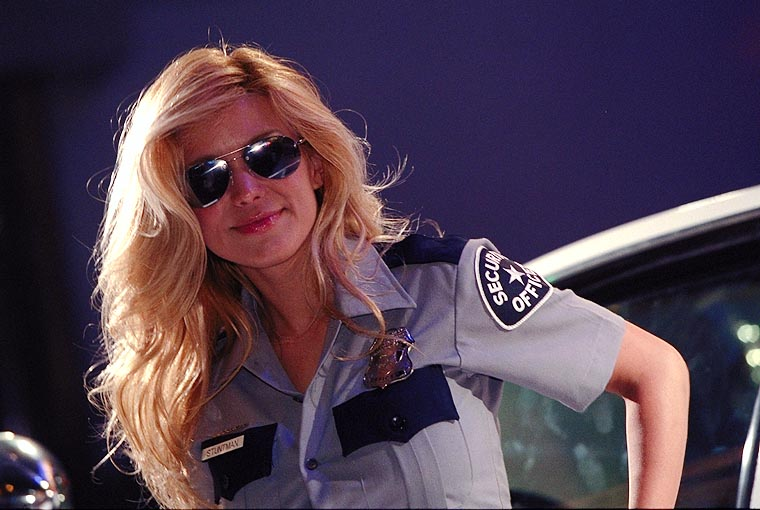 http://wingedmammal.com/action_photos_2001/e3_2001_policewoman_booth_babe.jpg